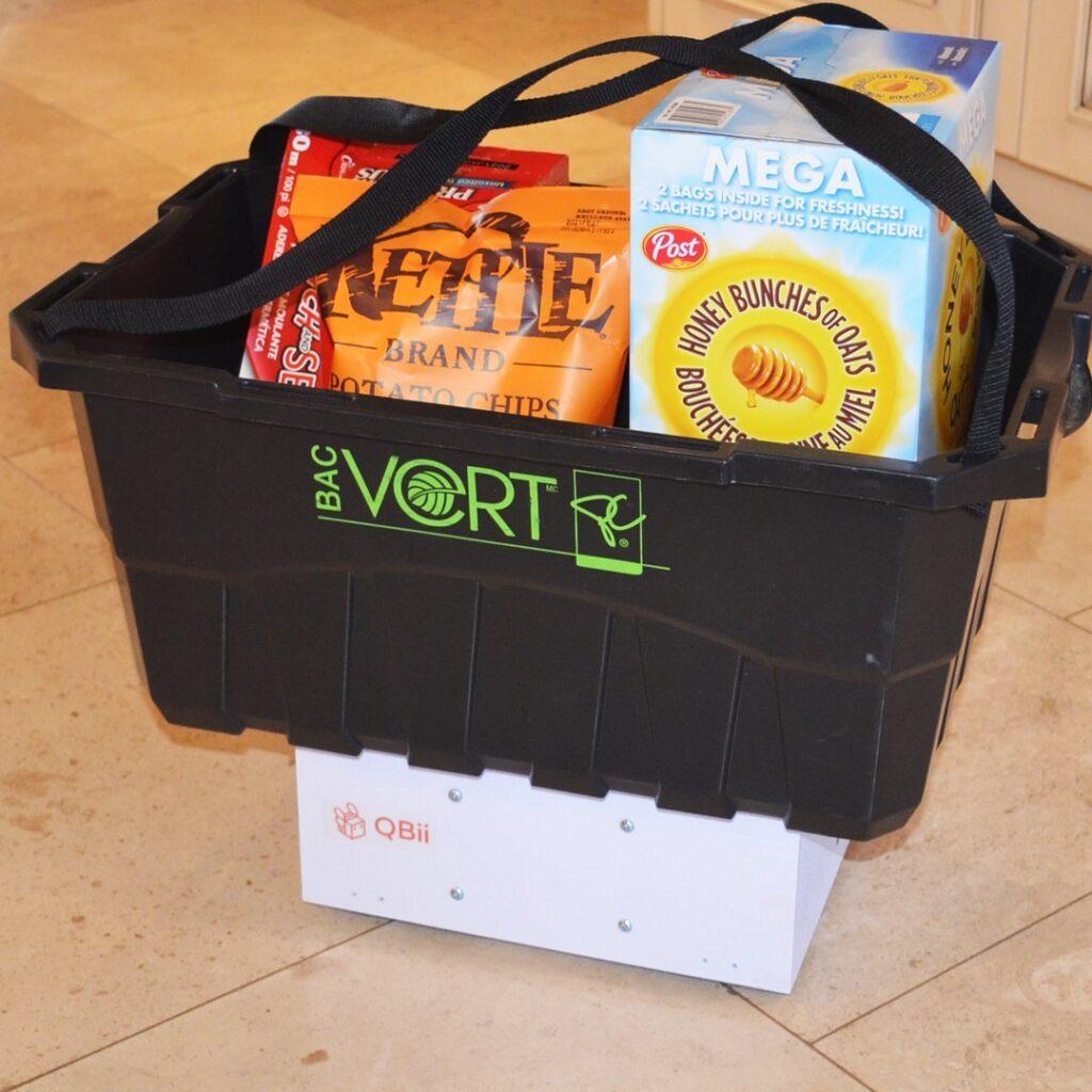 QBii carrying a bin